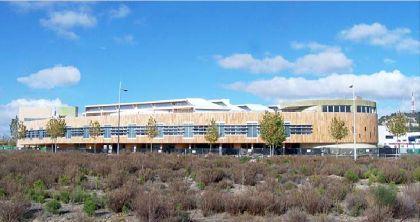 edificio de oficinas y talleres