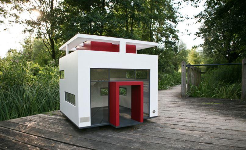 10 casas para perros con algo m s que madera y pl stico for Caseta perro pequeno